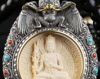 Amulet, Tibetan Buddhist protection reliquary Manjushri and Garuda mammoth ivory, solid silver 925. mantra turning on the back