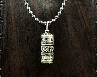 Tibetan Buddhist reliquary. Mill has opening prayer. Mantra of compassion. Silver 925