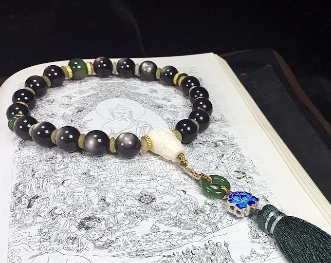 Wrist mala. Ch'an and Zen Buddhist rosary. 18 silver obsidian beads, nephrite jade. silver lotus 925 cloisonné. Buddha