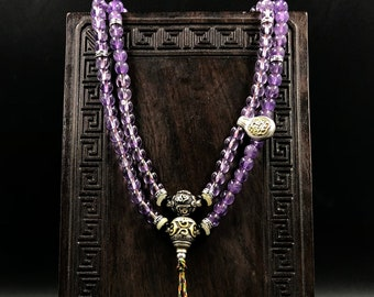 mala, Buddhist rosary.  108 amethyst beads, silver 925, mantra of compassion Om Mani Padme Hum.