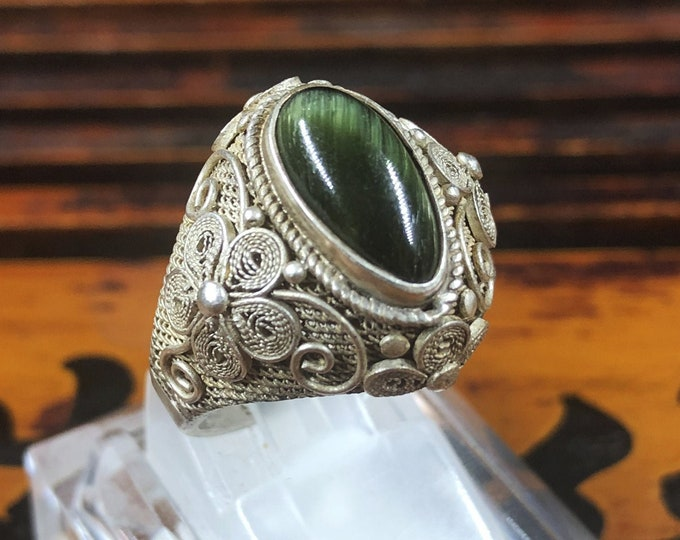 Silver ring 925 watermark. Green tourmaline has cat eye effect. Traditional Beijing jewelry. One-of-a-kind