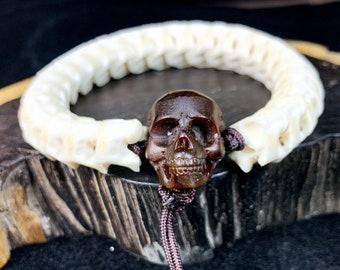 bracelet, in, snake vertebra, royal python. snake bracelet. Skull in buffalo horn. Sustainable creation. Clasp by sliding knot.