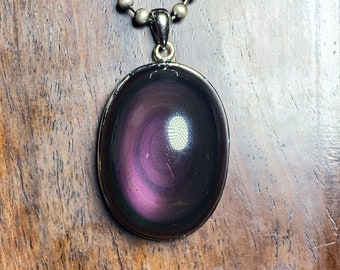 Pendant, obsidian eye celeste ,from Mexico, of high quality. 925 silver crimping. Dimensions 42/25/16mm. Natural obsidian.