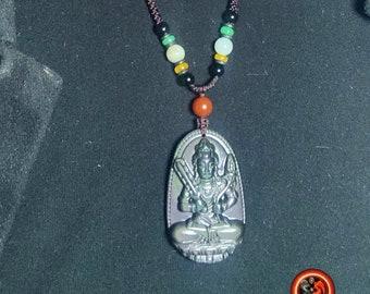 Pendentif, bouddha, Akashagarbha . Amulette bouddhiste, obsidienne oeil celeste. obsidienne oeil celeste naturelle du mexique. Cordon, jade.