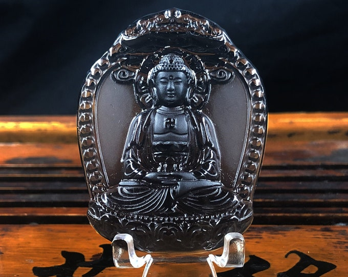 Amulet, Buddhist pendant. Obsidian ice. Amitabha, Buddha dhyana, meditation Buddha of the pure lands of the west