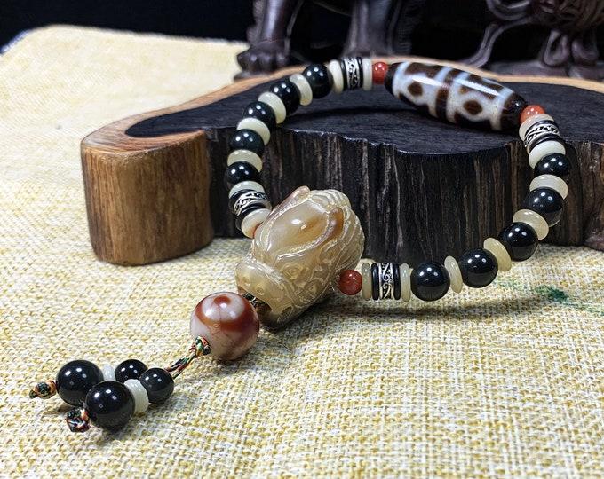 Bracelet agate sacrée tibétaine DZI. Dzi à six yeux  protection bouddhiste tibétaine. Obsidienne oeil celeste, dragon en os , argent 925