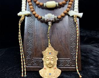 Mala, rosary of prayer and Buddhist meditation. 108 santan beads, bone, mother-of-pearl, Chenrezi/ Guan Yin pendant. Dorje and bell.