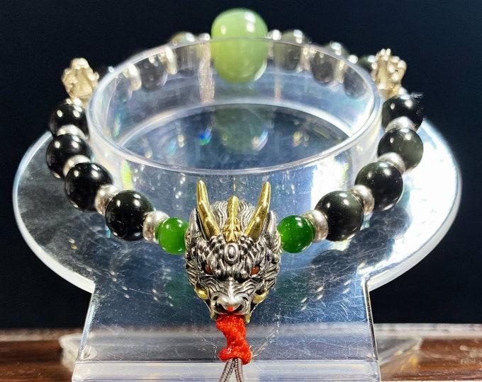 "Bracelet dragon. Dragon ""Yazi"". obsidienne oeil celeste, jade, agate dite""nan hong"" argent 925, cuivre, dorje et vajra bouddhisme tantrique."