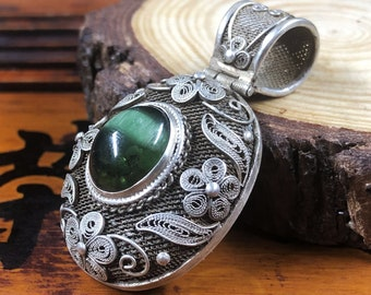 Silver pendant 925 watermark. Green tourmaline has cat eye effect. Traditional Beijing jewelry. One-of-a-kind