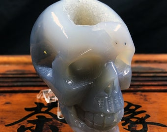 Crystal skull. hand-carved skull. Quartz geode on agate and rock crystal gangue. Unique piece