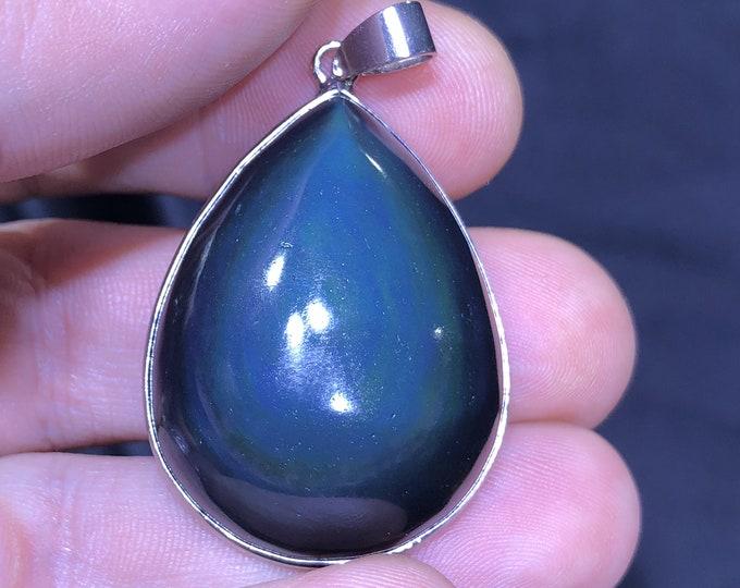 obsidian cabochon pendant celeste eye, set in silver copper.