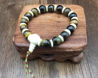 Buddhist wrist hens claw made of tiger eye beads/falcon eye and vegetable ivory