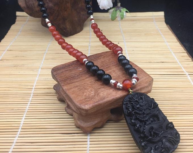 Obsidian collar celeste eye, cornaline, silver 925/ 1000th. Imperial dragon pendant in black obsidian, Pixiu back donuts.