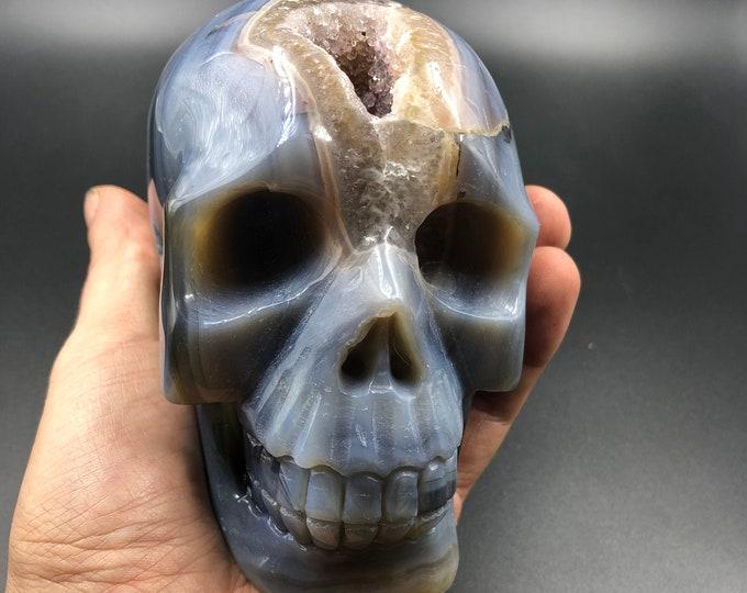 Crystal skull. hand-carved skull. Quartz geode on agate gangue. Unique piece
