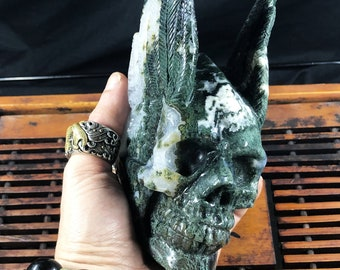 Winged crystal skull. hand-carved skull. quartz prase, agate moss. one-of-a-kind piece.