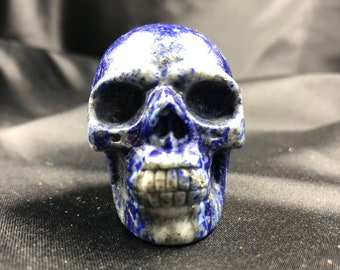 Crystal skull. Skull carved by hand lapis lazuli . 5cm in length.