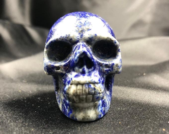 Crystal skull. Skull carved by hand lapis lazuli . 5cm in length.