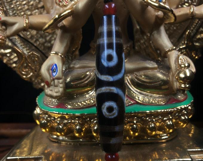 DZI, Tibetan sacred agate. Buddhist protection and Ben. Three eyes. mounted on leather drawstring sliding clasp. Cornalines in finish