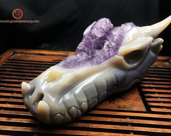 Large crystal dragon skull. Hand-carved dragon in an amethyst geode on gangue (Brazil). Unique piece 1,550kg