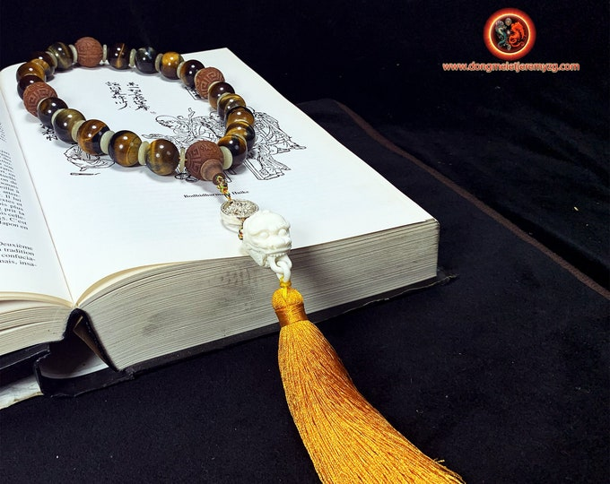 Wrist mala. Ch'an and Zen Buddhist rosary. 18 pearls in tiger's eye, guardian lion in buffalo bone. sandalwood beads.