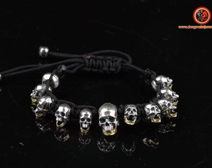 Bracelet cranes, skull. silver 925, movable lower jaw in brass Braided with rope for ultra resistant parachute, adjustable