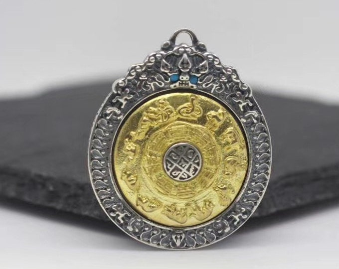 Buddhist amulet, Tibetan protection. Wheel of Buddhist life rotating on both sides. Silver 925 and copper. Arizona Turquoise