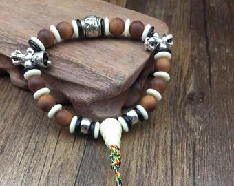 silver sandalwood bracelet, vegetable ivory. dorje and vajra silver pearl om mani padme hum