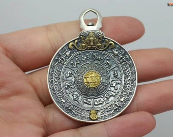 Buddhist amulet, Tibetan protection. Wheel of Buddhist life. Silver 925 and copper.