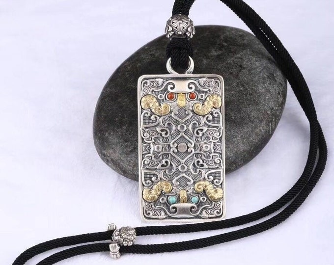 """Feng Shui pendant. Protection of the taotie dragon. Silver 925, copper. Arizona Turquoise, agate called """"nan hong (red from southern Yunnan)"""