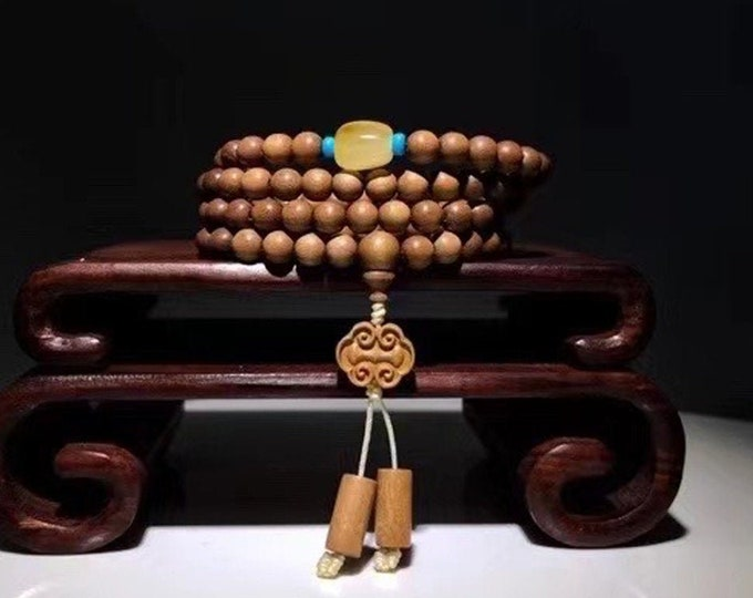 Rare, mala, Buddhist rosary, 108 Laoshan sandalwood beads, collection quality. Amber from Burma, turquoise.