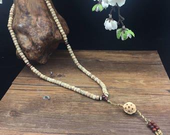 mala seeds of sacred fig (pipal), red sandal, lotus.