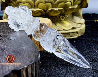 Phurba, the ritual object of Tibetan Tantric Buddhism. Natural rock crystal, about 10 cm long