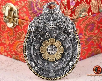 Buddhist amulet, Tibetan protection. Wheel of rotating Buddhist life. Double dorje on the back Silver 925 and copper.