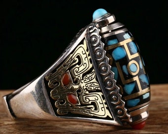 Tibetan Buddhist ring. DZI or sacred celeste stone of Tibetan protection with nine eyes. Pattern Taotie Silver 925, turquoise and nan hong