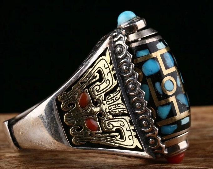 Tibetan Buddhist ring. DZI or sacred celeste stone of Tibetan protection with nine eyes. Pattern Taotie Silver 925, turquoise and nan hong