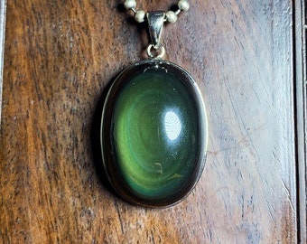 Pendant, obsidian eye celeste ,from Mexico, of high quality. 925 silver crimping. Dimensions 46/26/15mm. Natural obsidian.