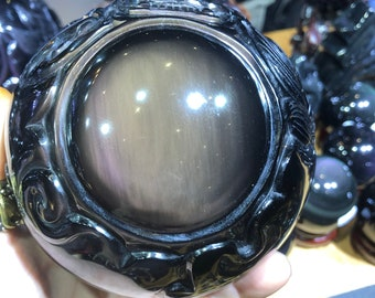 "obsidian sphere celeste eye. ""Dragon ball."" dragon completely sculpted by hand. 2,120 KG piece"