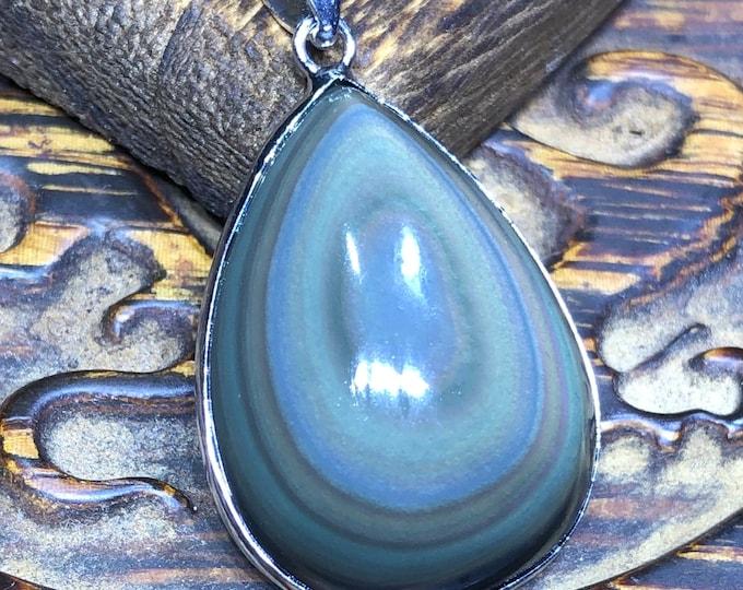 obsidian eye obchon pendant, set in surgical steel.