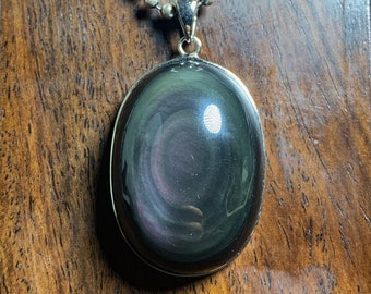 Pendant, obsidian eye celeste ,from Mexico, of high quality. 925 silver crimping. Dimensions 51/29/15mm. Natural obsidian.