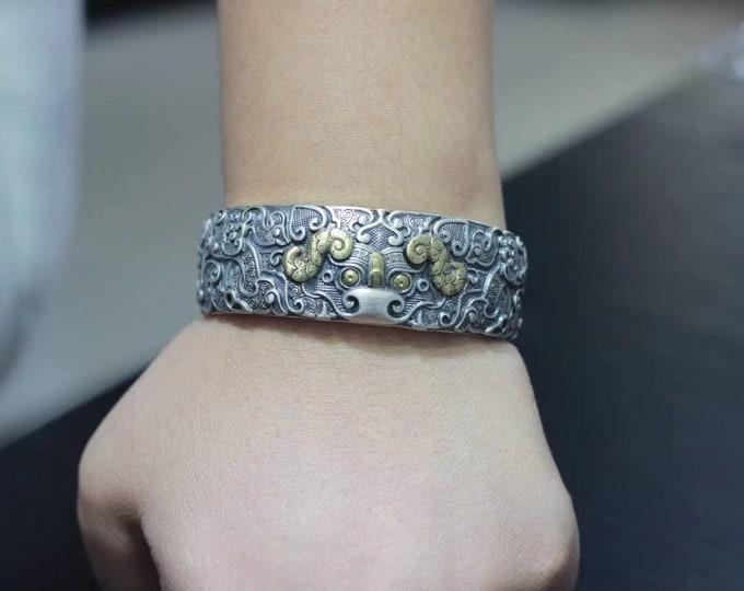 Feng Shui junk bracelet. Protection of the taotie dragon. Silver 925, copper.