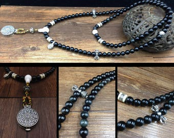 Obsidian mala celestial eye, Tibetan reliquary and sterling silver meter 925/1000th
