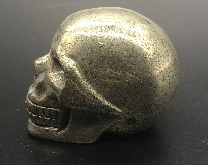 Crystal skull. Skull carved by hand pyrite. 5cm in length.