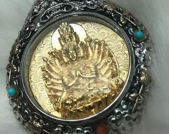 Tibetan Buddhist protection reliquary chenrezi thousand arms , solid silver 925 gold plated 18k turquoise nan hong. wheel of life