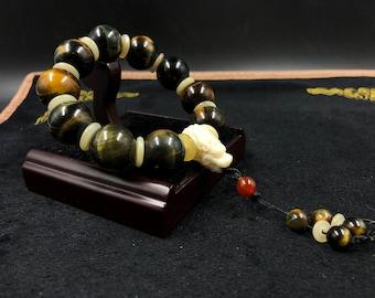 Big dragon bracelet tiger eye/falcon, 18mm cornaline yack bone beads.