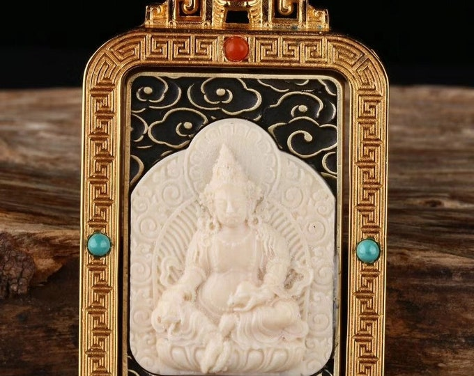 Tibetan Buddhist protection reliquary Jambhala , mammoth ivory, solid silver 925, turquoise bronze, agate called nan hong.