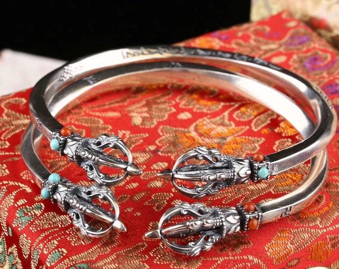 esoteric Buddhism bracelet (vajrayana) double vajra or double dorje. Silver 925, turquoise, agate called nan hong. Vajra turning.