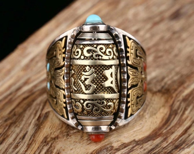 Tibetan Buddhist ring. Prayer mill mantra of compassion. Pattern Taotie Silver 925, turquoise and nan hong