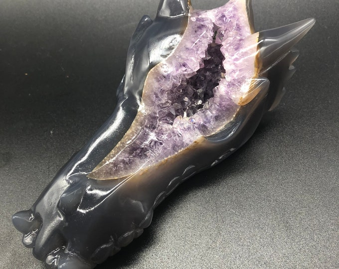 crystal dragon skull. Hand-carved dragon in a amethyst geode on rock crystal and agate gangue. Unique piece