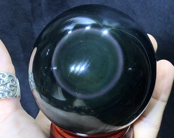 Large sphere in obsidian eye celeste quality A. 0.563 kg 25.9cm circumference 8.24cm in diameter