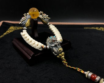 Double dragon bracelet. Silver 925, copper, python vertebrae, red and yellow amber from Burma, turquoise, agate called nan hong